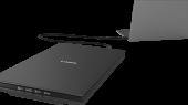 CanoScan LIDE 300 preto com um computador do lado direito
